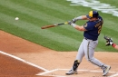 Brewers fall to Phillies, 6-5, after getting bad news on Christian Yelich's back