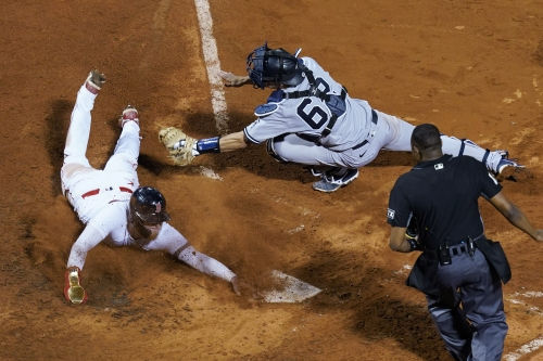 Yankees lose to Red Sox in extras after lengthy rain delay; drop eight games behind first place Boston