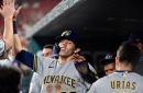 Brewers beat the Cardinals in extras, 6-4