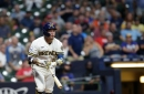 Brewers hit Reds bullpen hard in late rally for 7-4 win