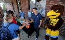 Marquette basketball coaches Shaka Smart and Megan Duffy welcome back students as excitement builds for the new year
