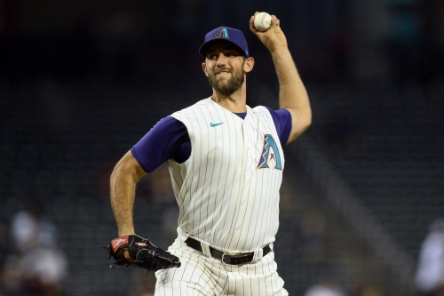 'I couldn't get a grip': Madison Bumgarner says the balls were slick in start vs. Mariners