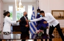 Giannis visits Greece as his mom and brother become citizens