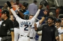 Marlins' Chisholm HRs twice, scores on wild pitch in 10th