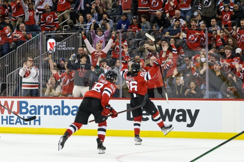 Jack Hughes delivers in OT as Devils beat Blackhawks 4-3 in season opener