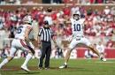 Auburn rumbles over Arkansas, 38-23