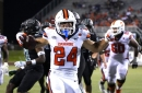 SU wearing white helmets & jerseys, orange pants vs. Virginia Tech