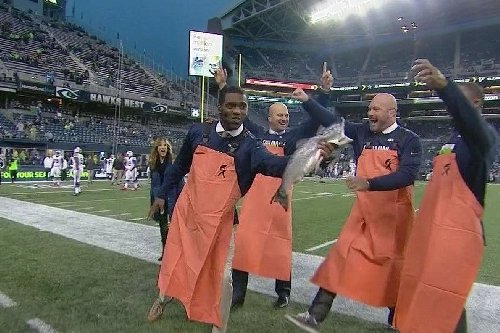 Randy Moss can catch anything one-handed, even a large salmon