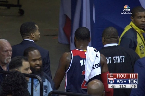 John Wall was ejected for brushing into a referee on his way back to the huddle