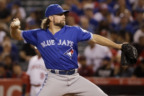 42-year-old knuckleballer RA Dickey agrees with Braves The Associated Press