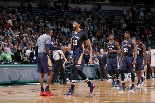 Davis, Holiday lift Pelicans past Blazers, 113-101 The Associated Press