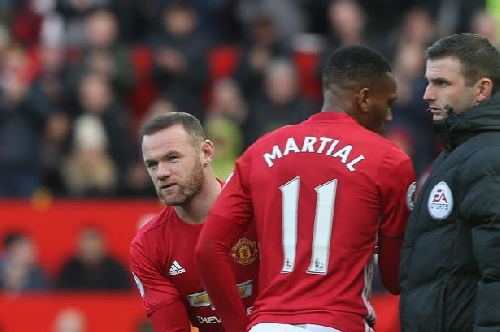 Was Manchester United striker Wayne Rooney's reaction to media treatment justified?