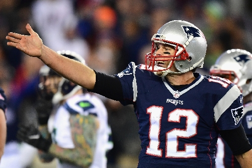 Brady shoots for win record against reeling Rams