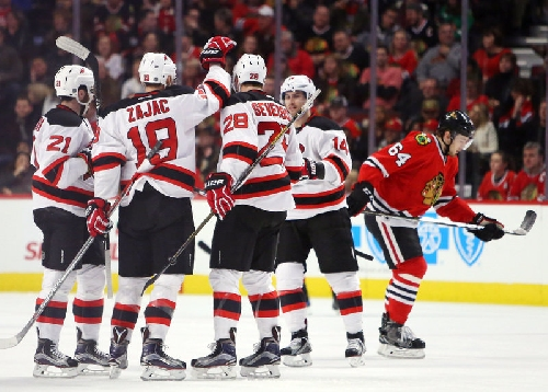 Travis Zajac's hat trick not enough as Devils fall to Blackhawks in OT | Rapid reaction