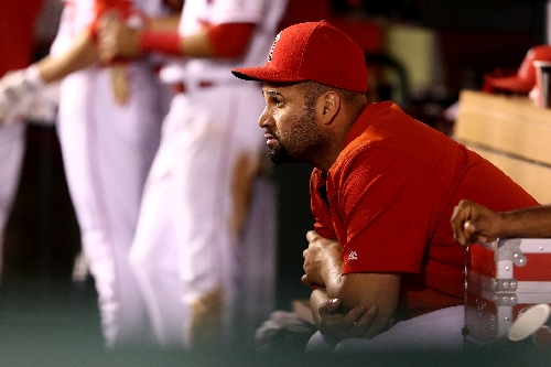 Foot surgery could sideline Pujols through MLB Opening Day
