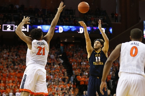 West Virginia Mountaineers Overcome Early Struggles To Defeat Virginia 66-57