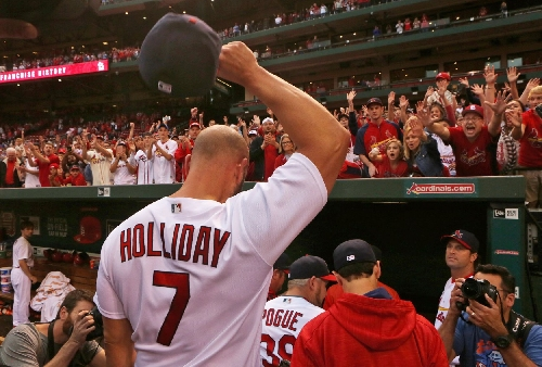 Holliday fitted for pinstripes, signs deal with Yankees