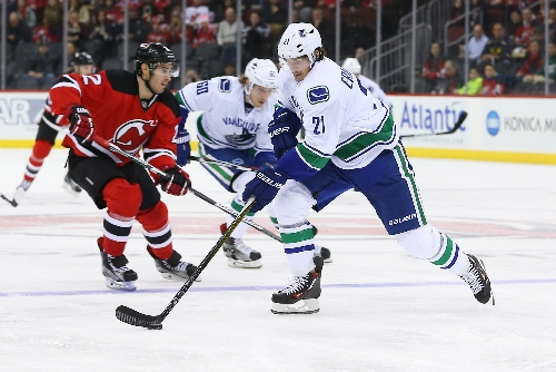 Canucks' Philip Larsen stretchered off ice after hit from Devils' Taylor Hall (VIDEO)
