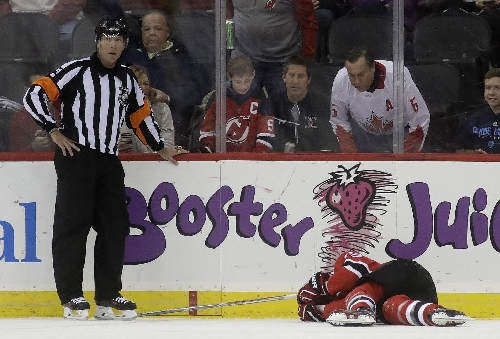 Canucks defenseman Larsen taken off ice on stretcher The Associated Press