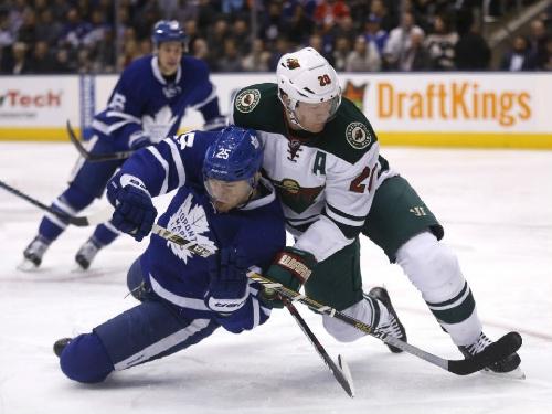 Devan Dubnyk makes 35 saves as Minnesota Wild notch seventh straight victory over Toronto Maple Leafs