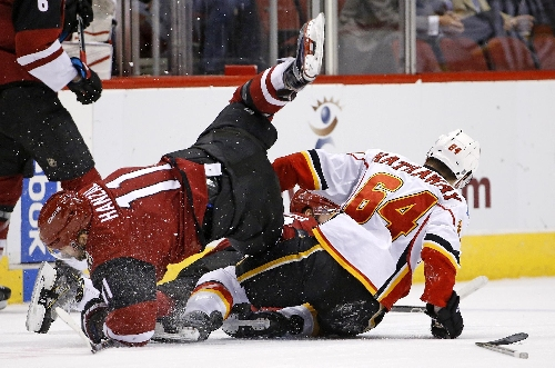 Flames beat Coyotes 2-1 in overtime for fifth straight win The Associated Press
