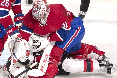 Devils cause Carey Price to get punchy but still fall to Canadiens