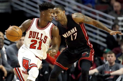 Butler, Wade lead Bulls to 105-100 win over Heat The Associated Press