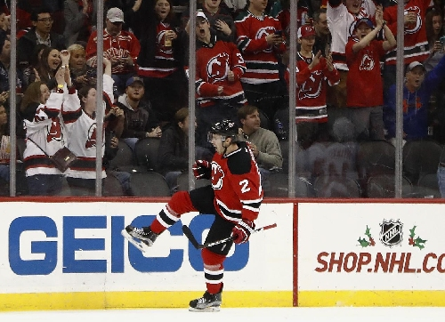 Devils defenseman John Moore removed from ice on stretcher The Associated Press
