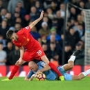 Liverpool's Adam Lallana, top, and Manchester City's Pablo Zabaleta battle for the ball during the English Premier League soccer match Liverpool against Manchester City at Anfield, Liverpool, England, Saturday, Dec. 31, 2016. (Dave Howarth/PA via