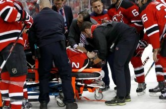 Video: Devils defenseman John Moore leaves ice on stretcher after hit from behind