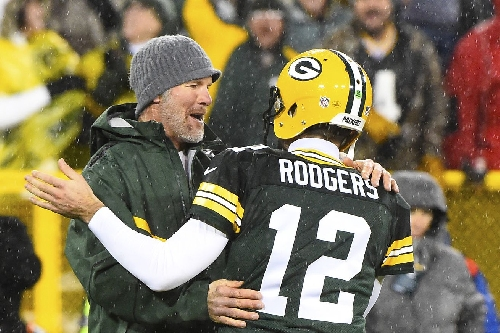 How does Aaron Rodgers stack up against Brett Favre in the playoffs?