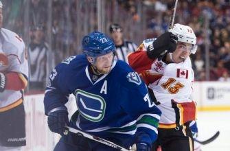 Granlund, Miller lead Canucks past Flames, 4-2