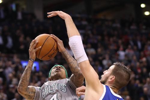 Valanciunas, DeRozan lead 4th quarter comeback, Raps beat Celtics 114-106