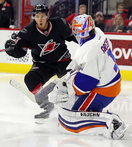 McGinn has goal, 3 assists and Canes beat Isles 7-4 The Associated Press