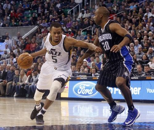Rodney Hood injured, Jazz beat Magic 114-107 The Associated Press