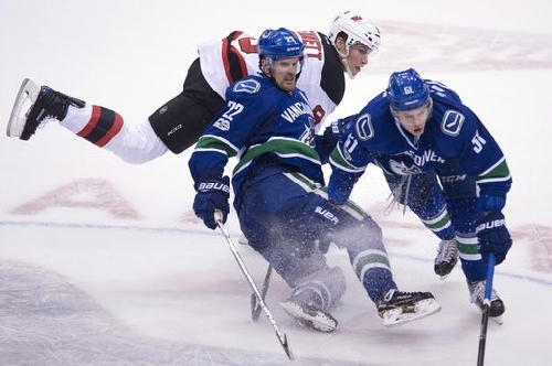 Hall scores in OT, Devils beat Canucks 2-1 The Associated Press