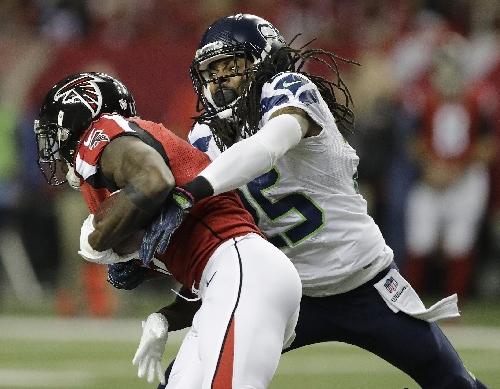 Carroll: Sherman played 2nd half of season with knee injury The Associated Press