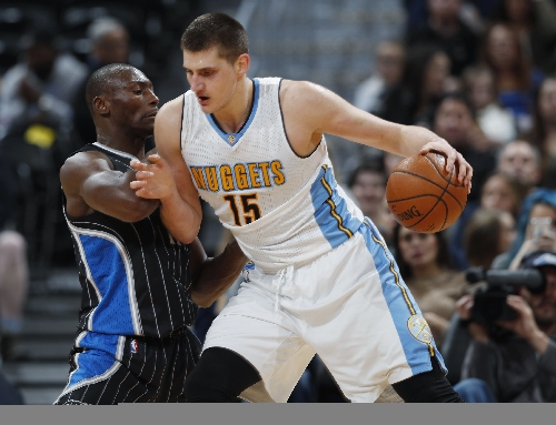 Nuggets stay hot on offense, rout Magic 125-112