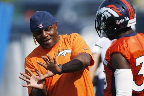 Broncos promote Joe Woods to defensive coordinator The Associated Press