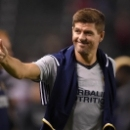 FILE - In this Feb. 9, 2016, file photo, Los Angeles Galaxy midfielder Steven Gerrard, gestures to fans after a soccer match against Club Tijuana, in Carson, Calif. Gerrard is returning to Liverpool, England, it was announced Friday, Jan. 20, 2017, to tak