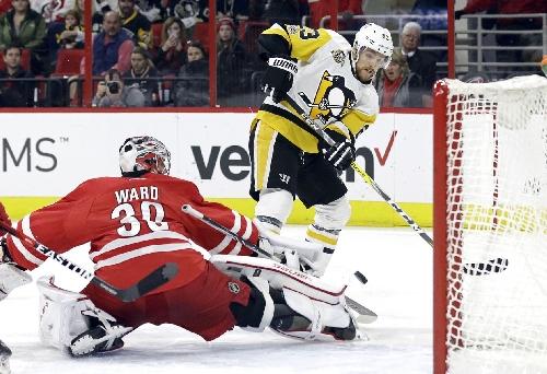 Big 2nd period helps Penguins beat Hurricanes 7-1