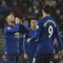 Manchester United's Wayne Rooney, left, celebrates after scoring from a free kick during the English Premier League soccer match between Stoke City and Manchester United at the Britannia Stadium, Stoke on Trent, England, Saturday, Jan. 21, 2017. (AP P