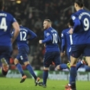Manchester United's Wayne Rooney, centre, celebrates after scoring from a free kick during the English Premier League soccer match between Stoke City and Manchester United at the Britannia Stadium, Stoke on Trent, England, Saturday, Jan. 21, 2017. (AP