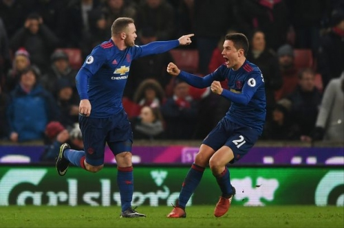 Wayne Rooney reacts to breaking Manchester United goal record