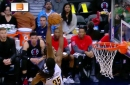 Kenneth Faried goes to the top floor to block DeAndre Jordan