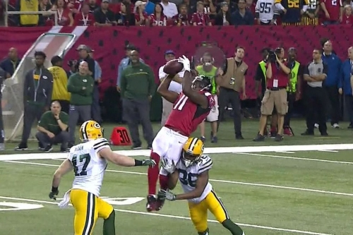 Julio Jones leaps and hangs on to an exceptional catch to set NFL playoff history