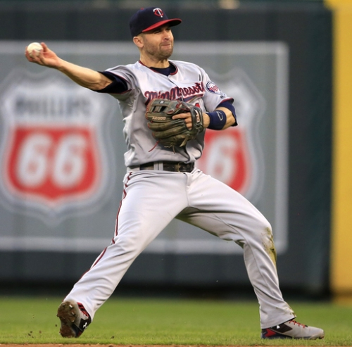 Trade talks cooled, 2B Brian Dozier happy to stay with Twins The Associated Press