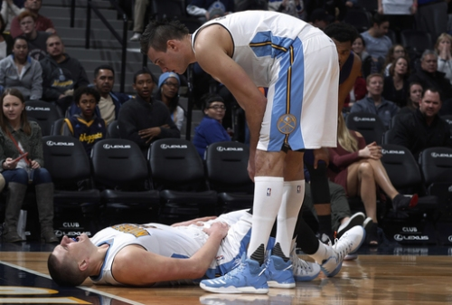 Nuggets' Jokic has 27 points, 14 rebounds before late injury The Associated Press