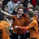 Wolverhampton Wanderers' Richard Stearman, centre, celebrates scoring his side's first goal of the game with his teammates during the FA Cup, fourth round soccer match between Liverpool and Wolverhampton Wanderers, at Anfield, in Liverpool, Engla