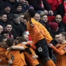 Wolverhampton Wanderers' Richard Stearman, celebrates scoring his side's first goal of the game with his teammates during the FA Cup, fourth round soccer match between Liverpool and Wolverhampton Wanderers, at Anfield, in Liverpool, England, Satur